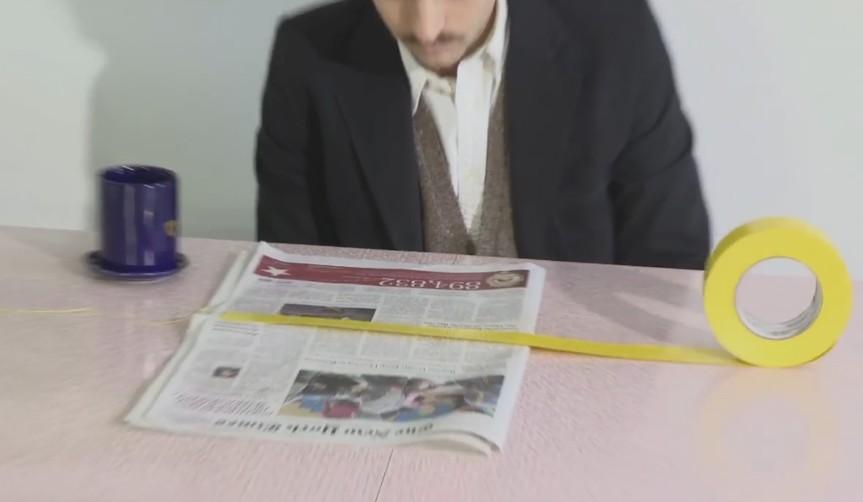 pasar una página de periódico